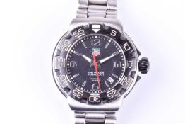 A Tag Heuer Professional Formula 1 quartz wristwatch, the black dial with large numerals and baton