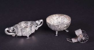 A Chinese silver export small bowl with clear glass liner, the twin handles formed as dragons and