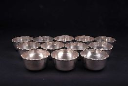 A set of twelve Continental silver finger bowls, each with frilled edge, marked 'Silver' to base,