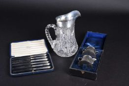 A silver mounted cut glass water pitcher, Birmingham 1938, together with a cased set of silver-