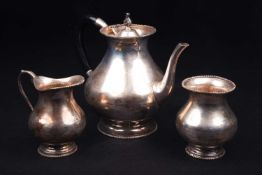 A Continental white metal three-piece teaset, marked 'Silver', comprising teapot, sucrier and