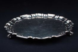 A mid-20th century silver salver, Sheffield 1958 by Walker & Hall, of scalloped edge form on three