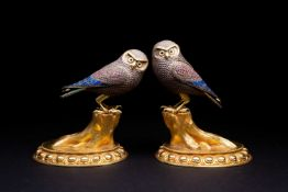 A large pair of silver and silver gilt owls, 20th century, with gilt beak and brows, one with