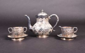 A Chinese silver part tea set, comprising teapot, milk jug, sugar bowl and two saucers, each with