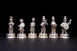 A set of six Spanish silver musician figures, 20th century, playing a variety of instruments, on