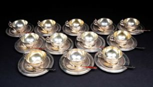 A set of twelve Syrian silver dowry cups and saucers, marked 'Silver' to the bases, together with