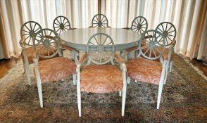 Neunteilige Sitzgruppe mit Tisch und Armlehnsessel im klassizistischen Stil.