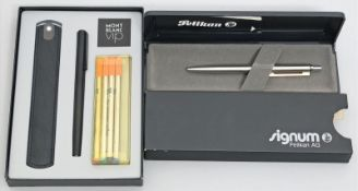 Kugelschreiber und Rollerpen.