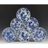 China, serie van acht blauw-wit porseleinen borden, Kangxi,