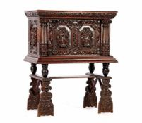 Antique oak cabinet with richly carved decor with columns, carved ornaments on the door with 2