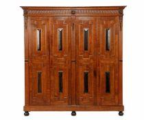 Oak 4-door cabinet with Renaissance-style features, carved frieze, lion masks, flutes, cushions