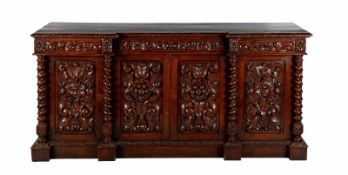 Dutch oak sideboard with richly carved decoration of masks, vine leaves and with twisted columns, 98