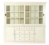 2-part white cabinet with 2 doors, 10 drawers and shelves behind the 2 sliding doors, 210 cm high,