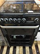 1 HARROGATE DOUBLE OVEN WITH 4 HOB IN BLACK / CONDITION REPORT: ALL GLASS SMASHED ON DOORS, KNOB