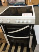 1 DOUBLE OVEN WITH 4 HOBS IN WHITE / CONDITION REPORT: HEAVILY USED, FRONT GLASS PANEL TO TOP OVEN