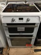 1 LOT TO CONTAIN AN UNTESTED HOTPOINT HUI612P ELECTRIC DOUBLE OVEN COOKER / RRP £499.00 / ITEM HAS