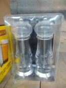 1 LOT TO CONTAIN 1 X SET OF ANIKA SALT AND PEPPER GRINDERS BOXED.