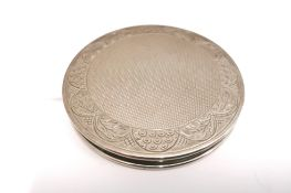 A lady's silver compact by Henry Cifford Davis Ltd, Birmingham 1961. 8cm in width. Approximately