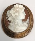 A fine oval 15ct (tested) mounted cameo of a lady with floral and grape accessories to hair. The