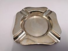 A Sheffield silver ash tray dated 1944. 10 cm in width. Approximately 94g
