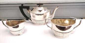 Three piece Victorian silver half lobed bachelor's tea set, Sheffield 1898. Makers Joseph