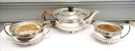 Three piece silver ovoid half lobed tea set with Gadroon decoration. London 1919, makers Daniel &