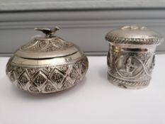 Two late 19th century Indian white metal pots with covers (a.f)