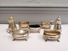 A collection of seven miscellaneous silver condiments featuring two peppers and five mustard/