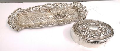 A Birmingham silver trinket box dated 1906 by B.C having foliage design to hinged lid containing a