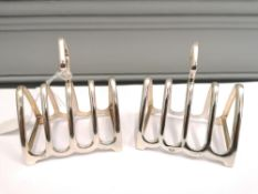 Pair of silver four section toast racks, Birmingham 1931. Makers W J Myatt & Co. Approximately 84g