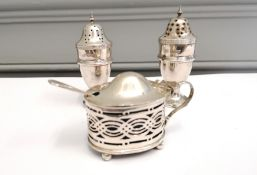 A pair of silver pepperette Chester 911 together with a Birmingham silver salt date 1912.
