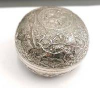 A late 19th century Indian bomb shaped box with cover having a repousse/chasing jungle design