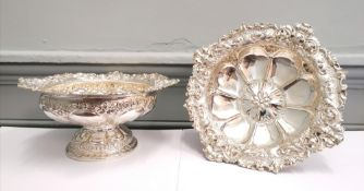 Fine pair of chased silver Victorian comports with floral decoration to the top rim and base,