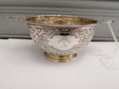 A Victorian Sheffield silver gilt quaich having pieced handles to top with repousse/chased foliage
