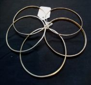 A collection of five various 9ct gold 375 bangles. 22g approximately.