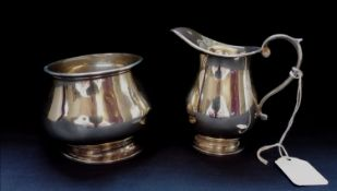 A Birmingham silver cream jug dated 1947 by Henry Matthews. 9cm in height (a.f) together with a