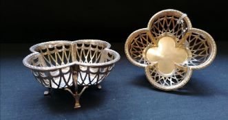 Matched pair of silver pierced quatrefoil bonbon dishes on claw feet. Makers Harry Synyer &