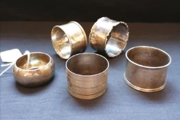 A collection of five various napkin rings. 3.17ozs/90g approximately.
