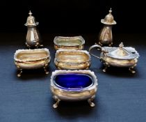 A collection of seven miscellaneous silver condiments featuring two peppers and five mustards/salts.