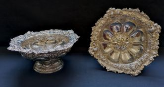 A fine pair of chased silver Victorian comports with floral decoration to the top rim and base.