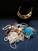 A bag containing miscellaneous costume jewellery.