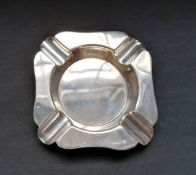 A Sheffield silver ash tray dated 1944. 10cm in width. 94g approximately.