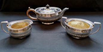 Three piece silver ovoid half lobed tea set with gadroon decoration. London 1919, makers Daniel &