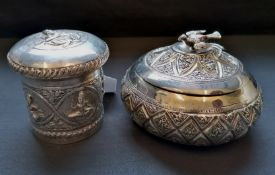 Two late 19th century Indian white metal pots with covers (a.f).