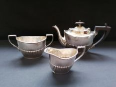 Three piece Victorian silver half lobed batchelor~s tea set. Sheffield, 1898. Makers Joseph