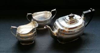 A three piece silver oval tea set with scalloped edge. Edinburgh, 1933. Makers Hamilton & Inches.