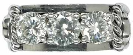 Ringe Exklusiver Damenfingerring. 750er WG, gestempelt. 20. Jh. Besatz aus drei Brillanten, zwei