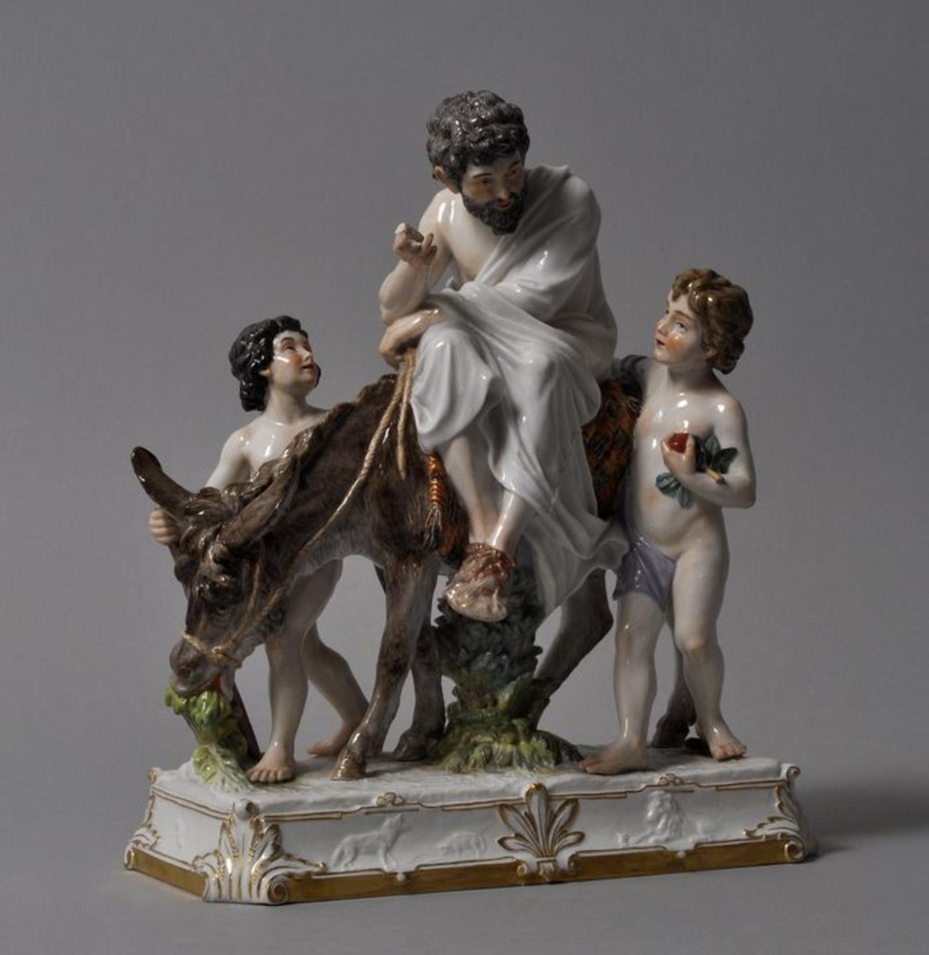 Los 51 - Äsop, auf einem Esel reitend, Meissen, ca. 1900Modell Heinrich Möller 1898. Gruppe von drei...