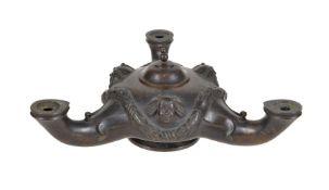 A bronze tripartite oil lamp in ancient Pompeiian style