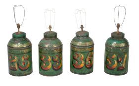 † A set of four green and gilt painted tea canisters